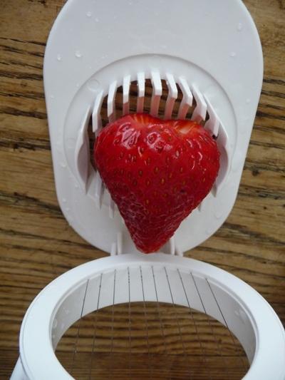Slice strawberries with an egg slicer
